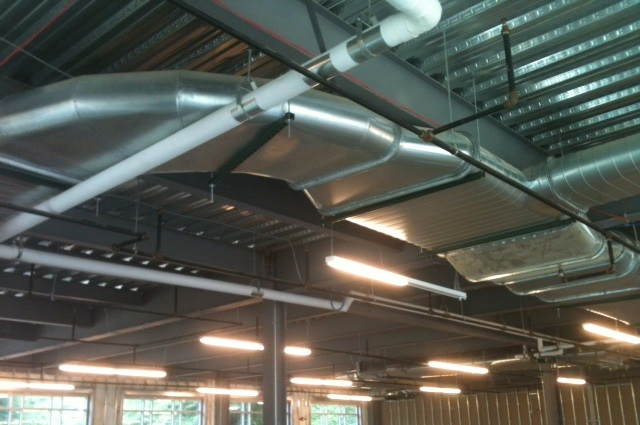 Installation of ductwork above ceiling at MCR Saftey Office